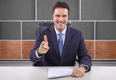 Male news anchor in studio — Stock Photo