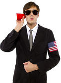 American spy holding cup — Stock Photo