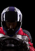 Racer wearing racing suit and helmet — Stock Photo