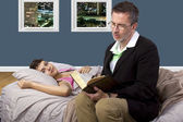 Dad is tutoring daughter in bedroom — Stock Photo