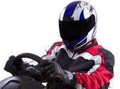 Racer on steering wheel — Stock Photo