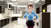 Female redhead in 3d kitchen — Stock Photo