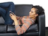 Woman is playing video game — Stock Photo