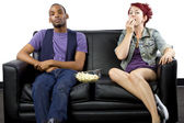 Male and female sharing couch — Stock Photo