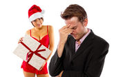 Girlfriend stressed boyfriend on christmas — Stock Photo