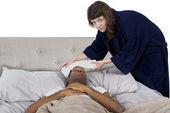 Female taking care of sick boyfriend — Stock Photo
