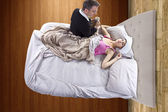 Father taking care of sick daughter — Stock Photo