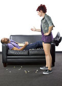 Female angry at male making mess — Stock Photo