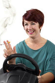 Female smoking while driving — Stock Photo
