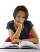 Female studying with text book — Stock Photo