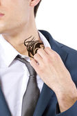 Businessman revealing hidden tattoo — Stock Photo