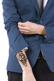 Businessman revealing hidden tattoo — ストック写真