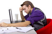 Tired worker with laptop — Stock Photo