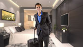 Businessman travelling with luggage — Stock Photo