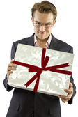 Male presenting valentines gift — Stock Photo