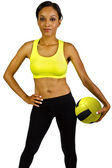 Female athlete with yellow volleyball — Stockfoto