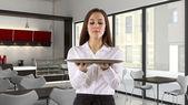 Young female waitress holding  blank — Stockfoto