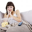 Постер, плакат: Teenager watching movies in bed with popcorn