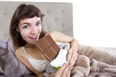 Girl eating junk food before going to bed — Stock Photo