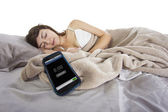 Female snoozing modern cell phone alarm clock — Stock Photo
