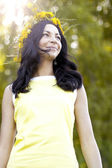 Beautiful girl smiling in the park — Stock Photo