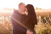 Couple kissing in autumn outdoors — Stock Photo