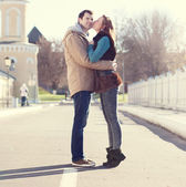 Couple kissing in autumn city — Stock Photo