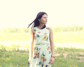 Beautiful woman on a summer field — Стоковое фото