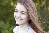 Little smiling girl on nature — Stock fotografie