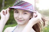 Little girl wearing a hat outdoors — Stock Photo