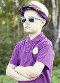Boy in a cap and glasses outdoors — Stock Photo