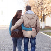 Young couple walking in autumn city — Stock Photo