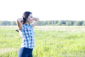 Woman  looks into the distance outdoors — Stock Photo