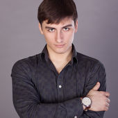 Young man looking confidently — Stockfoto