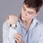 Young businessman, stud buttons — Stock Photo