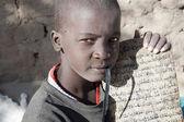 Junge und sein manuskript auf arabisch — Stockfoto
