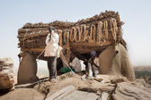 Men at work near the Toguna of the village, Mali, Africa. — Stock Photo