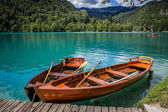 Boats at the pier of the Bled Island, Lake Bled, Slovenia. — Stock Photo