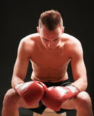 Young handsome boxer man isolated on black background — Foto de Stock