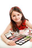 Little girl with cosmetics. Isolated on white background. — Stock Photo