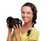 Beautiful young woman with camera.Isolated on white background — Stock Photo