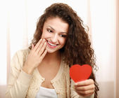Beautiful smiling caucasian woman with heart symbol — Stock Photo