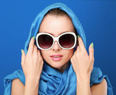 Portrait of an attractive young woman in sunglasses. Retro style. — Stock Photo