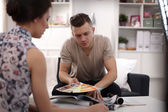 Couple choosing paint swatch for new home — Stock Photo