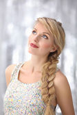 Beautiful blonde young woman with braid hairdo — Stock Photo