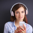 Smiling girl with headphones isolated on grey background — Stock Photo #51489511