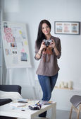 Woman is a proffessional photographer with camera — Stock Photo