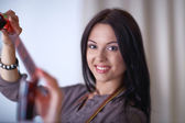 Young woman watching footage on film — Stock Photo