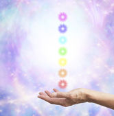 Holding Chakra Energy in open hand — Stock Photo