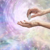 Crystal healer sensing energy with terminated quartz — Stock Photo